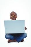 Sitting boy using laptop Stock Image