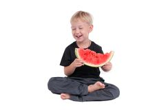Sitting boy with watermelon Royalty Free Stock Photo