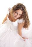 Sitting bride looking up. Sitting curled bride looking up isolated over white Royalty Free Stock Images