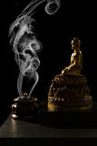 Sitting Bronze Budda with Incense Burner Royalty Free Stock Photography