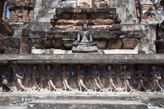 Sitting Buddha in base Wat Mahathat. In Sukhothai Historical Park Royalty Free Stock Photos