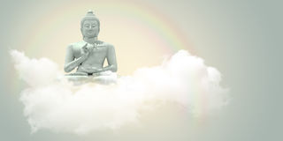 Sitting Buddha in the clouds. Royalty Free Stock Photography