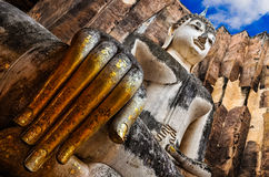Sitting Buddha with golden hand in Wat Si Chum temple, Sukhothai Royalty Free Stock Photography
