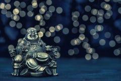 Sitting buddha Golden statue Vintage toned. Sitting buddha. Golden statue on blurred background. Vintage toned photo stock photos