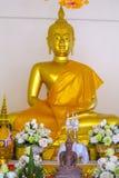 Sitting Buddha golden statue inside the wat thai temple. Buddha statue in a Buddhist temple Wat in Thailand. Statue of seated, standing or lying Gautama Buddha stock image