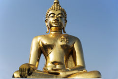 Sitting Buddha in Golden triangl. Statue of gold Buddha in Golden Triangl in Thai Royalty Free Stock Photography