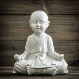 Sitting buddha. Meditation and relaxing concept vintage Stock Photography