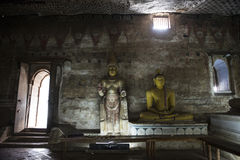 Sitting Buddha into the Royal Rock Temple, Dambulla, Sri Lanka. Royal Rock Temple, paintings, frescoes and sculptures of Buddha, sitting Buddha, in Buddhist stock photography