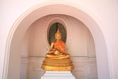 Sitting Buddha statue holding alms bowl Royalty Free Stock Photo