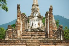 Sitting Buddha statue at the ruins of the main chapel of the Wat Mahathat temple in Sukhotai Historical Park, Thailand. Stock Images