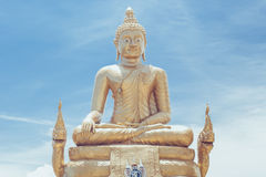 Sitting Buddha statue in Thailand over blue sky Stock Image