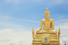 Sitting Buddha statue in Thailand over blue sky Royalty Free Stock Photography