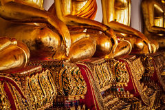 Sitting Buddha statues  details, Thailand Stock Photography