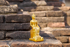Sitting Buddha. Statuette of a seated Buddha in the Thai monastery Stock Images