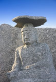 Sitting buddha with stone hat Royalty Free Stock Photography