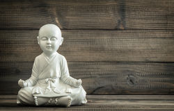 Sitting buddha. White statue. Relaxing concept vintage Stock Image