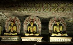 Sitting Buddhas in Dambulla Cave Temple Stock Images