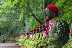 Sitting Buddhas in Kanmangafuchi abyss. Japan stock photography