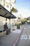 Sitting at the bus stop Stock Images