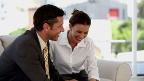 Sitting business people having fun while chatting. Together on a sofa stock footage