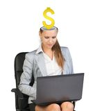 Sitting businesslady with dollar sign Royalty Free Stock Photography