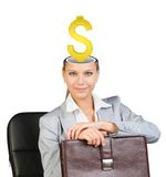 Sitting businesslady with dollar sign Royalty Free Stock Images