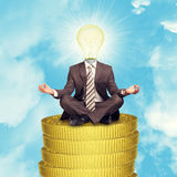 Sitting businessman on coins step Royalty Free Stock Image
