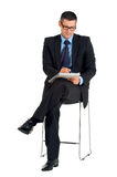 Sitting businessman with eyeglasses writing. In white background Royalty Free Stock Photography