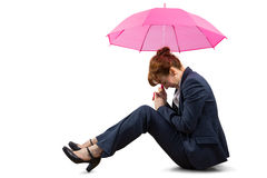 Sitting businesswoman holding pink umbrella Royalty Free Stock Image