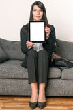 Sitting Businesswoman showing empty Tablet screen Stock Photos