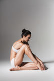 Sitting calm woman in white underwear Royalty Free Stock Photos