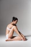 Sitting calm woman in white underwear Royalty Free Stock Photos