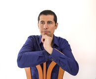 Sitting on a chair and thinking Royalty Free Stock Photo