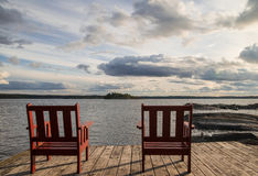 Sitting chairs near sea. Two sitting chair with a nice view on sea in Sweden Stock Photo