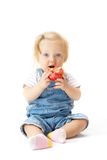 Sitting child with the apple Royalty Free Stock Images