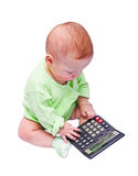 The sitting child with the calculator Stock Images