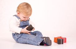 SItting child with gift boxes Royalty Free Stock Images