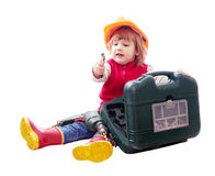 Sitting child in hardhat with tools Royalty Free Stock Image