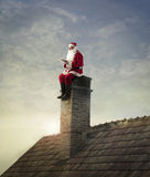 Sitting on the chimney Royalty Free Stock Image