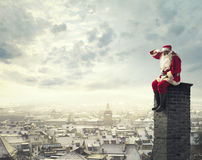 Sitting on the chimney Royalty Free Stock Photo