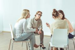 Sitting in the circle. Women are sitting in the circle during meeting Stock Images