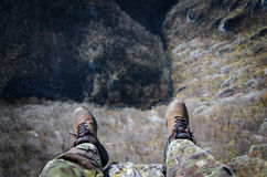 Sitting on a cliff Royalty Free Stock Images