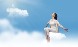 Sitting on a cloud. Girl sitting on a cloud Stock Photography