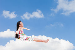 Sitting on the cloud over sky Stock Photos