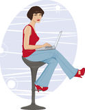 sitting by the computer Stock Photography