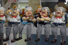 Sitting cook. Statuettes of a sitting cook Royalty Free Stock Image