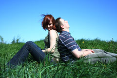 Sitting couple. Young couple sitting on the grass Stock Photos