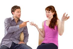 Sitting couple having an argument Royalty Free Stock Photos