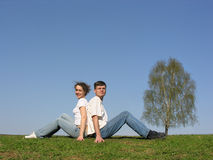 Sitting couple. spring. royalty free stock image