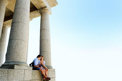 Sitting couple tourists ruins Royalty Free Stock Image